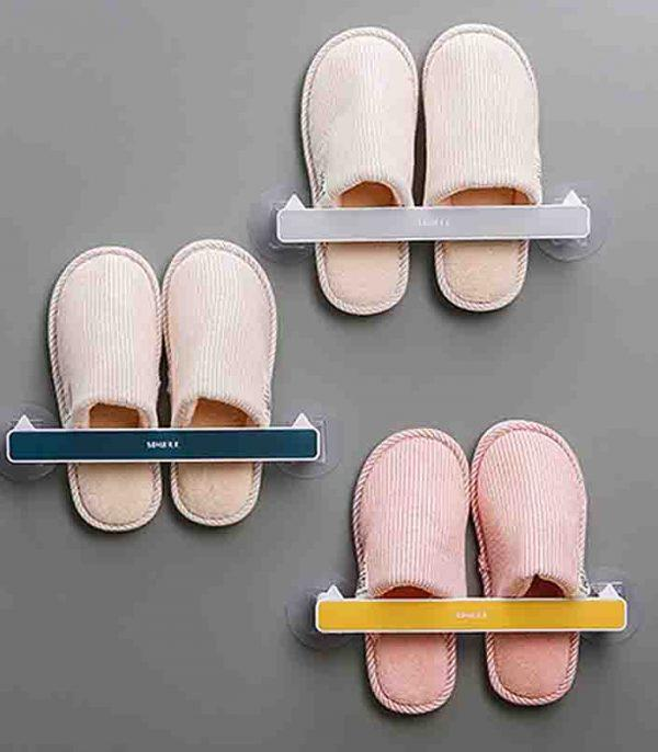 Easy to install on the wall surface with durable stick-on tape for organising your slippers, towel, or pot cover with this storage rack.